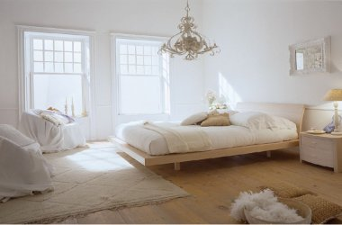 All white minimalist bedroom with blonde wood