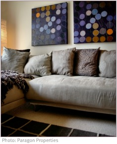 grey comfy sofa with artwork on the wall