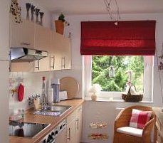 white kitchen with red blind