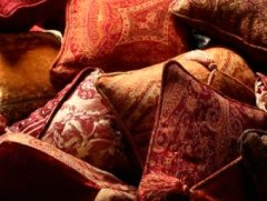 collection of cushions in shades of red and orange