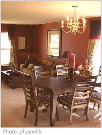open-plan brown-walled dining room with pale carpet