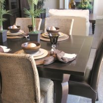 dining room with leather and wicker chairs
