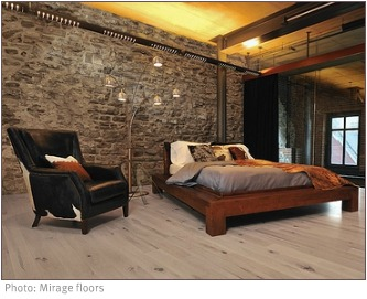 industrial bedroom with stone walls and blonde wood floor