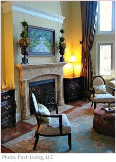 Tuscan decor fireplace and armchairs